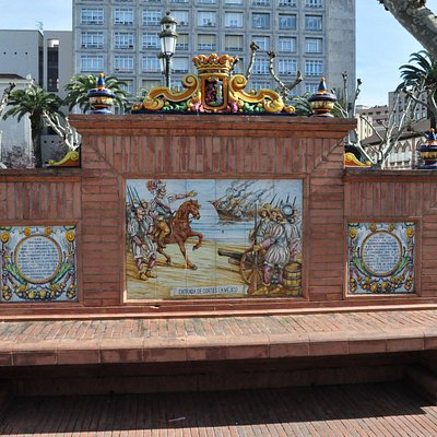 Bench with two decorated sides on the plaza.
