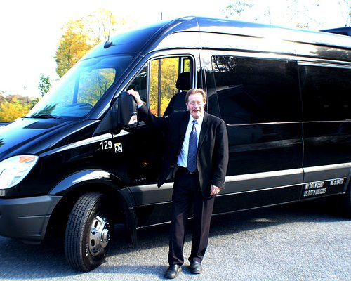 Our chauffeur Lance looking spiffy with one of our Sprinter Vans!
