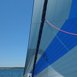 Relax on the trampoline during a scenic sail