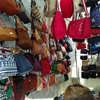 Hand bag display in market stall