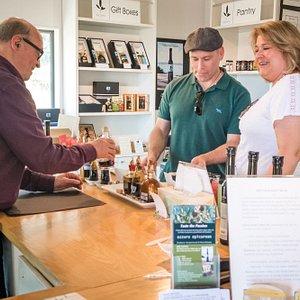 Happy customers at the tasting bar