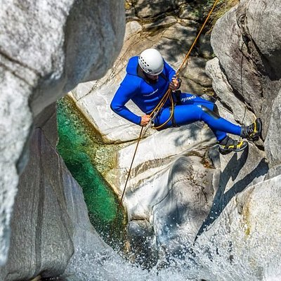 Canyoning guest abseiling in Boggera, one of Ticino's most beautiful canyoning tours.