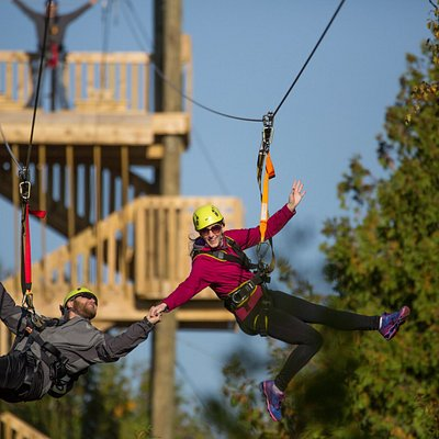 People zip lining on the course in Door County, WI