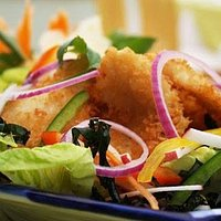 Crispy deep fried cod fish salad flavoured with green apples,peanuts, lime juice and chilli dres