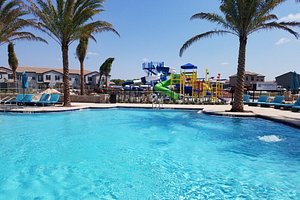 The pool with some of the water slides in the background