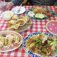 Clockwise from bottom right, pork w/noodles, pork dumplings, crab rangoon, and salmon w/vegetabl