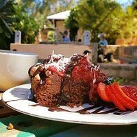 enjoy a slice of gluten free choc raspberry cake and a cup of coffee while the little ones play
