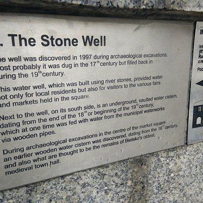 Stone well description plaquette