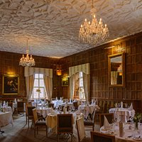 warm ambience, oak paneled walls and extensive wine cellar makes this the perfect dining destina