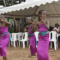 Kids dancing at Mama Rwanda sewing project completion event