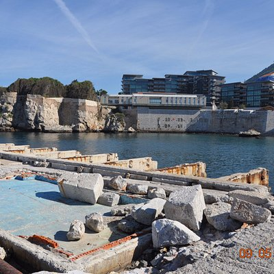 Rosia Bay - with broken piers and what looks to be once a paddling pool