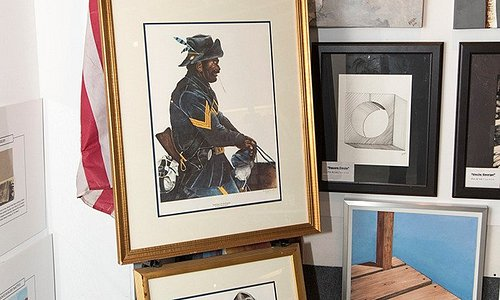 Artwork featuring a Buffalo soldier and a Black Cowboy.