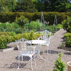 Elegant seats in the herb garden at Backhouse.