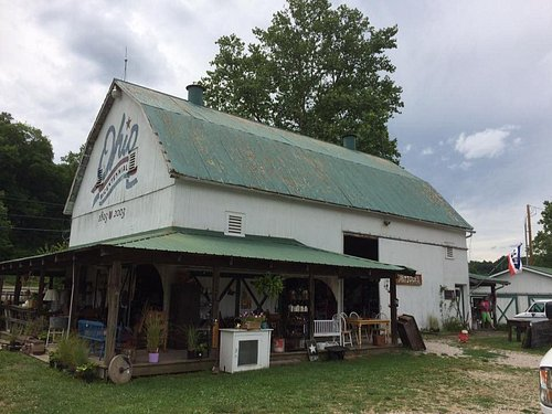 Hocking Hills Market. Large white Barn on the right upon entering complex.