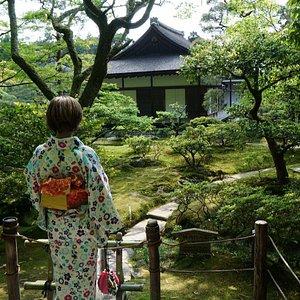Female kimono in a lovely garden