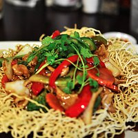 K4 - Crispy yellow egg noodle stir fried with vegetables, shrimp, beef, pork, and squid