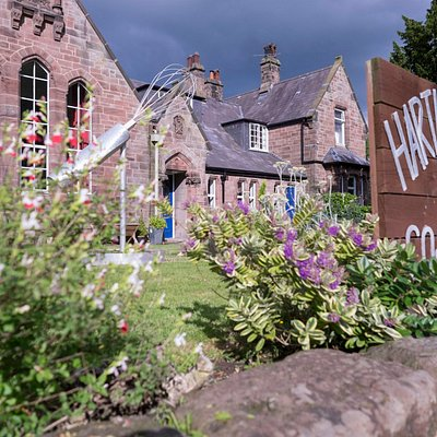 Former village school built traditionally from local sandstone, renovated now to a friendly cook