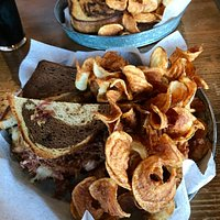 Wonderful Rueben Sandwich on marbled rye bread with homemade curly potato chips!