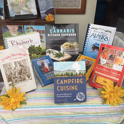 Store window featuring books about local foods, cooking & recipes