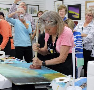 """Here Sue Pink """"takes the plunge"""" finishing her piece for the Paint Around."""