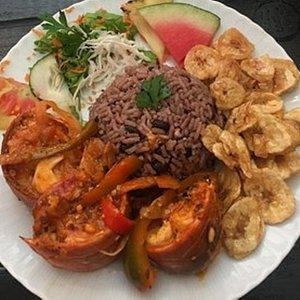 Lobster Enchilado, moros (black bean and rice mixture) and mariguitas (plantains)