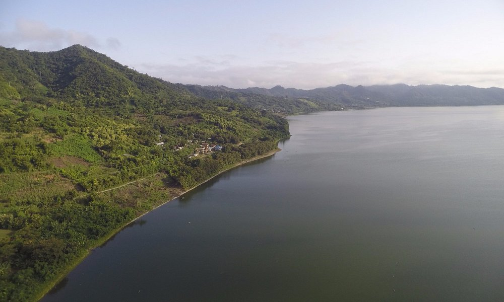 Lake is rounded with primary forest and hills