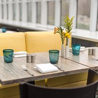 Table by the window, overlooking the Lily Pool Terrace. Photo credit: Daniel Krieger