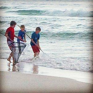 Enjoying our net on the beach.