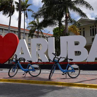 The sign of I love aruba, a place to go.