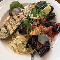 seafood medley with linguine (clams, mussels, lobster).