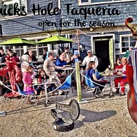 """Free music """"on the shells"""" outside Quicks Hole Taqueria in summer."""