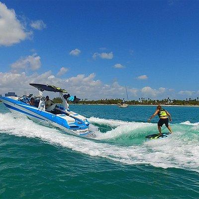 Wakesurfing behind the boat