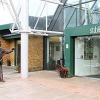 The entrance to The Stables, a statue of founder Sir John Dankworth pointing the way!