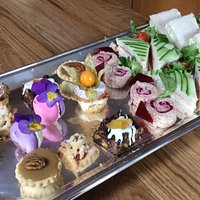 Selection of cakes and sandwiches