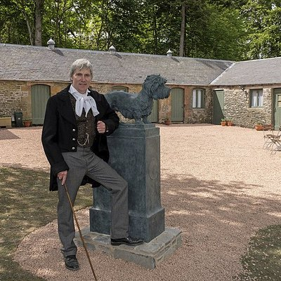 """""""Sir Walter Scott"""", by the """"Old Ginger"""" Dandie Dinmont statue with the old kennels behind"""