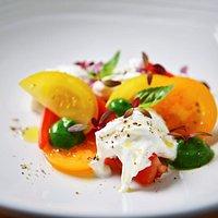 Heritage tomatoes, burrata, basil, black olive