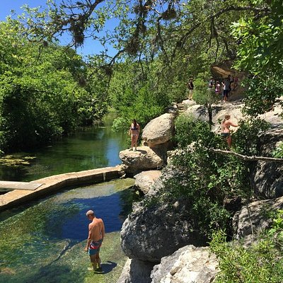 Jacob's Well is an artesian spring that releases thousands of gallons of water a day.