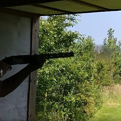 A friend mid-shot as he aims for the clays.