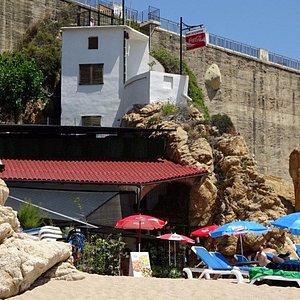 Sign at top reads Restaurant Rocapins, a fine beach restaurant/bar.