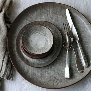 Bespoke Dinner Sets are our specialty. We texturize clay using burlap fabric.