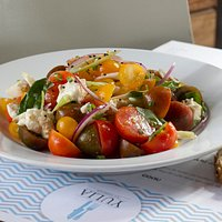 Caprese salad and anchovy- Fresh mozzarella, multicolored cherry tomatoes, red onions, toasted