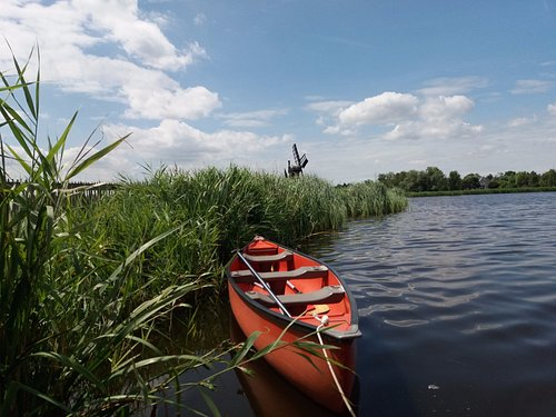 canoe in the wetlands with windmils