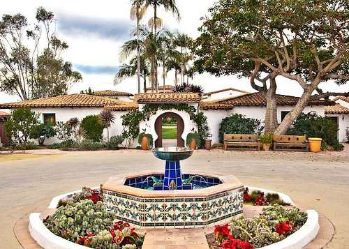 The entrance to Casa Romantica is accented by an ornate fountain with custom Spanish tiles.