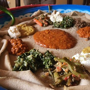Injera and Ethiopian dishes in Addis - Traveling Spoon