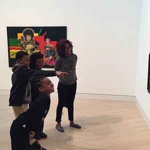 Visitors enjoying paintings by Jimi Jones