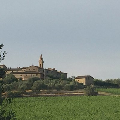 San Gusme and church overlooking vineyards surrounding her