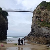 Bridge above house in the sea - low tide