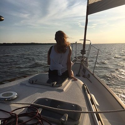 Beautiful woman riding on the bow of the Moonshadow.