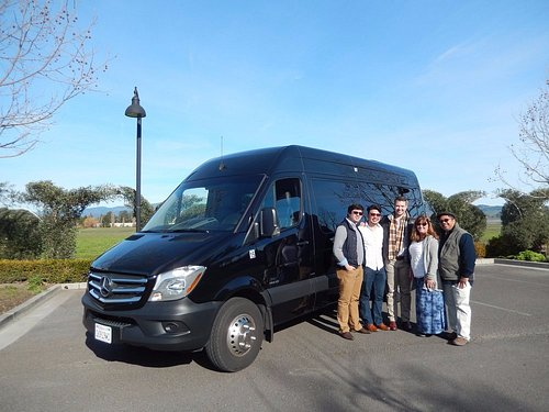 Outside a winery with the tour bus.
