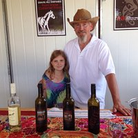 The winemaker and his daughter in the sampling room.